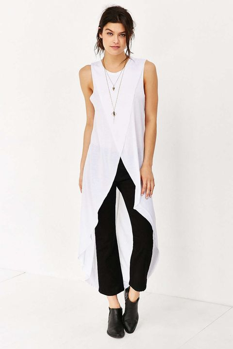 "<p>The problem with styling an open shirtdress over pants is that, for the chicest silhouette, you have to walk around with your hands in your pockets. This guy solves *that* problem while making it really easy to pretend you have a tail. </p><p>Truly Madly Deeply high-low tank top, $59, <a href=""http://bit.ly/1OvYFIQ"">urbanoutfitters.com</a>.</p>"