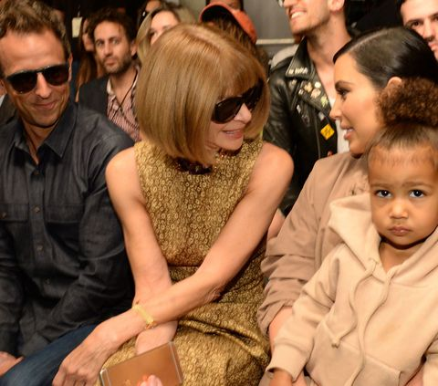 Seth Meyers, Anna Wintour, Kim Kardashian West and North West attend Kanye West Yeezy Season 2 during New York Fashion Week