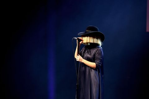 Standing, Hat, Headgear, Costume, Performance art, Acting, Stage, Sun hat, Scene, Costume design,