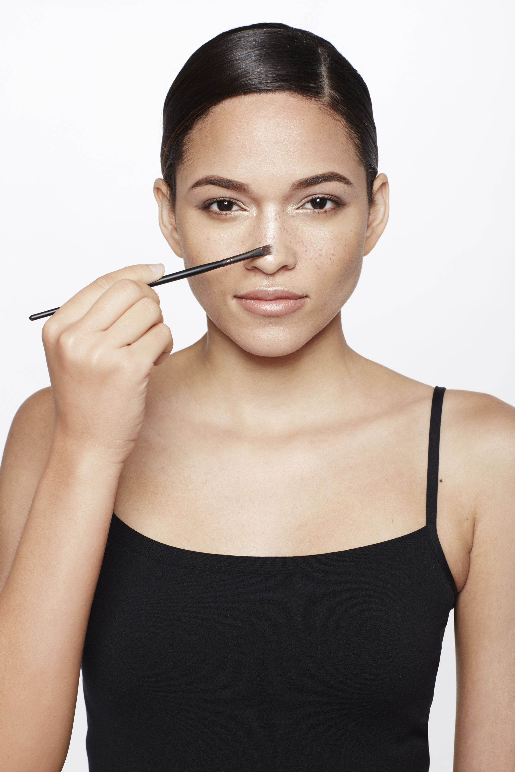 """<p>Refining the shape of your nose is as easy as drawing a narrow line with a light powder highlighter like <a href=""""http://www.lorealparisusa.com/en/products/makeup/face/blush/true-match-lumi-powder-glow-illuminator.aspx"""" target=""""_blank"""">L'Oréal Paris True Match Lumi Powder Glow Illuminator</a> from the top to the tip using a flat eye shadow brush. Jose's rule: """"The skinnier the line, the narrower your nose will look.""""</p>"""