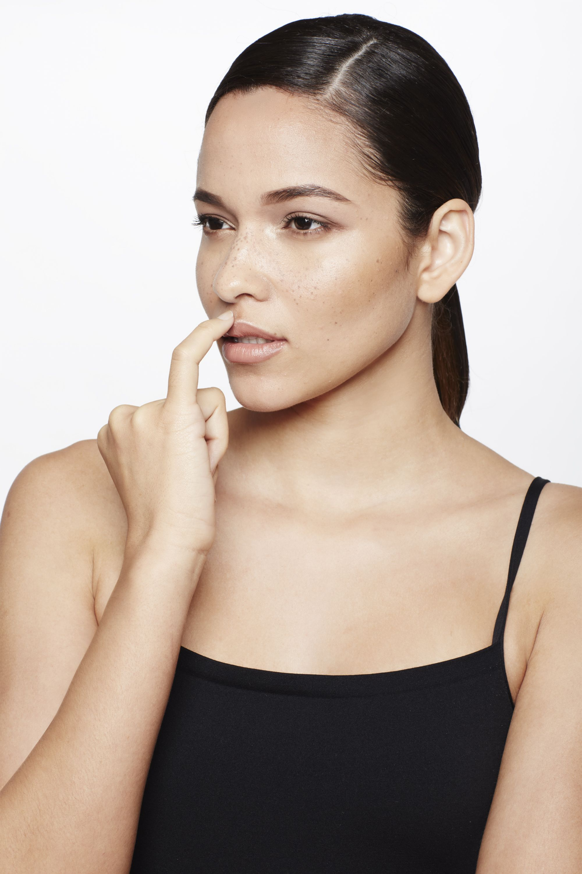 """<p>You don't need to resort to Kylie Jenner measures to make your lips seem fuller. With your pinky, dab a tiny bit of liquid highlighter, such as <a href=""""http://www.lorealparisusa.com/en/products/makeup/face/primer/true-match-lumi-liquid-glow-illuminator.aspx"""" target=""""_blank"""">L'Oréal Paris True Match Lumi Liquid Glow Illuminator</a>, just above your cupid's bow. """"The reflection of light creates an instant pouty effect,"""" says Jose.</p>"""