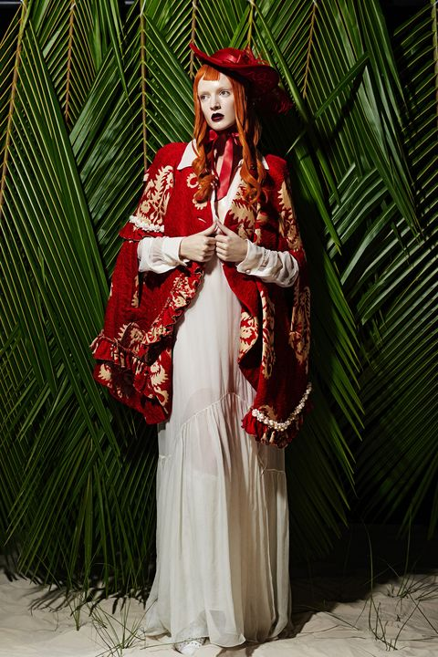 <p>Cape, $3,215, Simone Rocha; Dress, $3,495, Chloé; Hat, $225, Apatico; Boots, Price Upon Request, Altuzarra.</p>