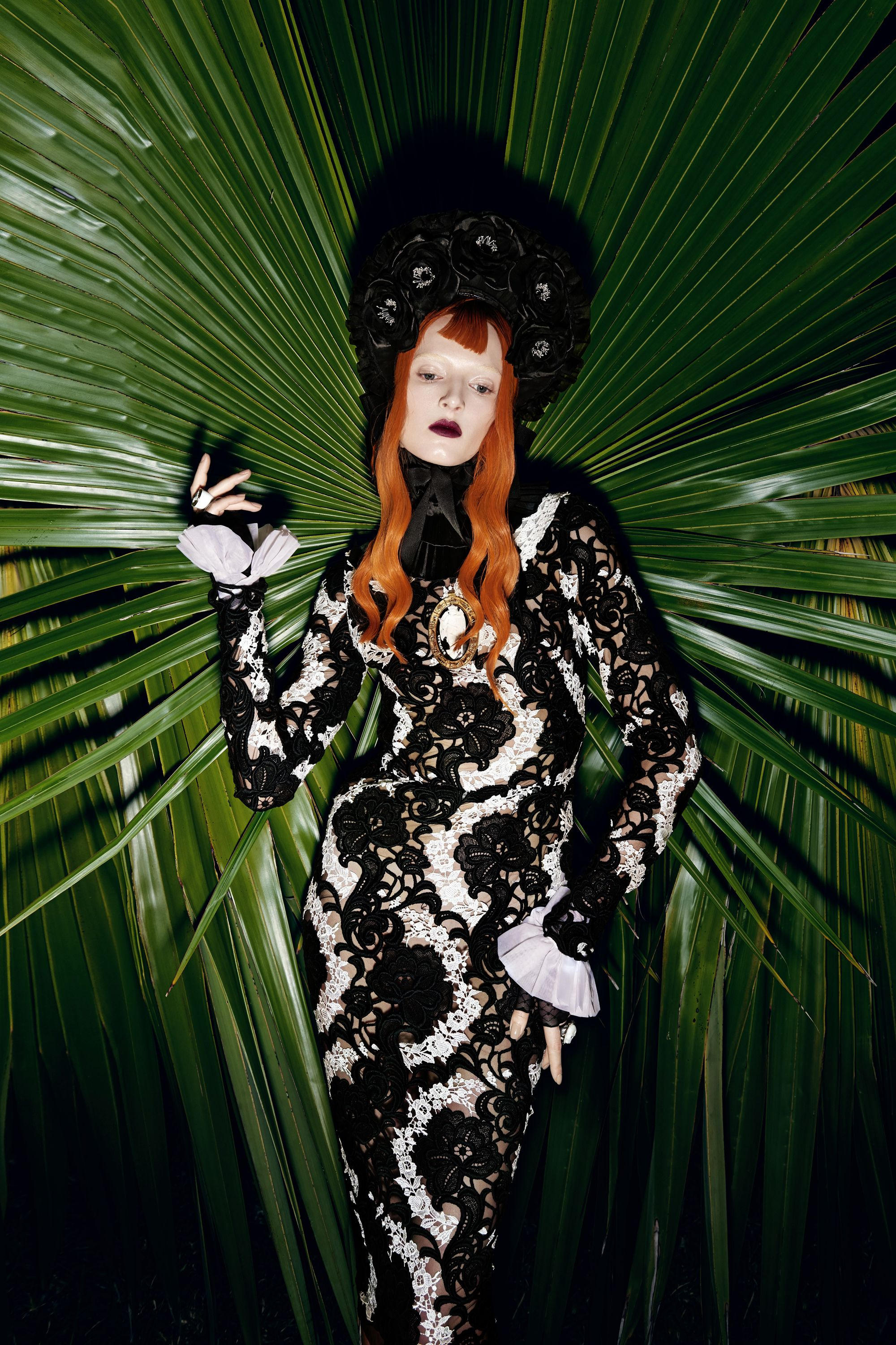 <p>As alluring as the french polynesian landscape, fall's victorian trend—black lace, high necklines, and fanciful flounces—turns up the heat.</p><p>Dress, Price Upon Request, Dolce & Gabbana; Bonnet, $275, Apatico; Collar, $120, Cuffs, $155, House Of Snowball; Pendant Necklace, $495, Ktz; Fingerless Gloves, $85, Cornelia James; Rings, From $2,035 Each, Amedeo.</p>