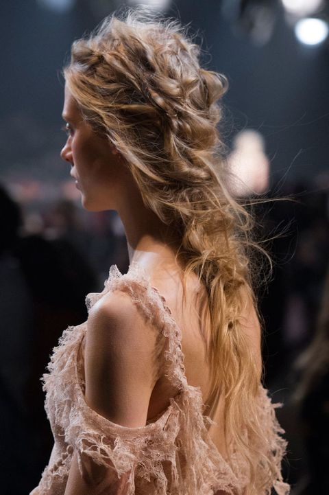 <p>Most epic hair goes to McQueen thanks to Guido Palau, who dreamed up the messiest, most ornate bohemian plaits we've ever seen. Inspired by slept-in hair, it still boasts some serious artistry, with Palau literally using a needle and thread to achieve a sewing-like ruched texture.</p>