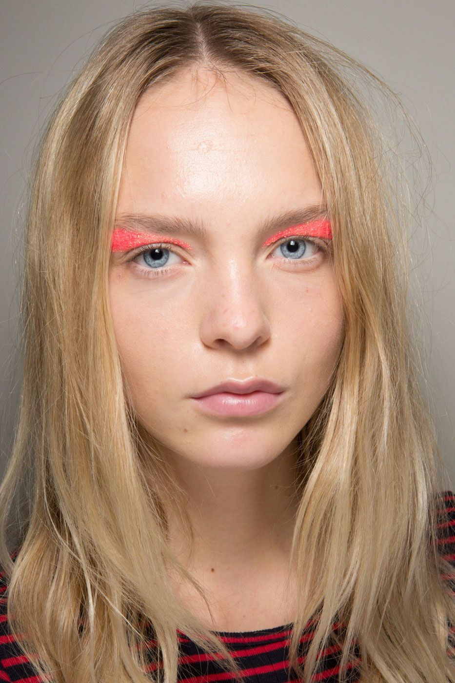 """<p>Eleven of the girls on the Valli runway were given  """"<a href=""""http://www.nytimes.com/2015/10/05/t-magazine/giambattista-valli-makeup-paris-fashion-week.html?_r=0"""" target=""""_blank"""">disco showers</a>,"""" according to makeup artist Val Garland, which meant a banana-shaped glitter application above the lids, just under the arches, in neon-bright shades. It's kind of like a subversive cat eye.</p>"""