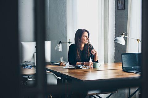 Table, Interior design, Furniture, Sitting, Fixture, Drinkware, Desk, Interior design, Transparent material, Lamp,