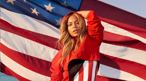 Sleeve, Textile, Red, Flag, Electric blue, Flag of the united states, Long hair, Lipstick, Costume, Independence day,