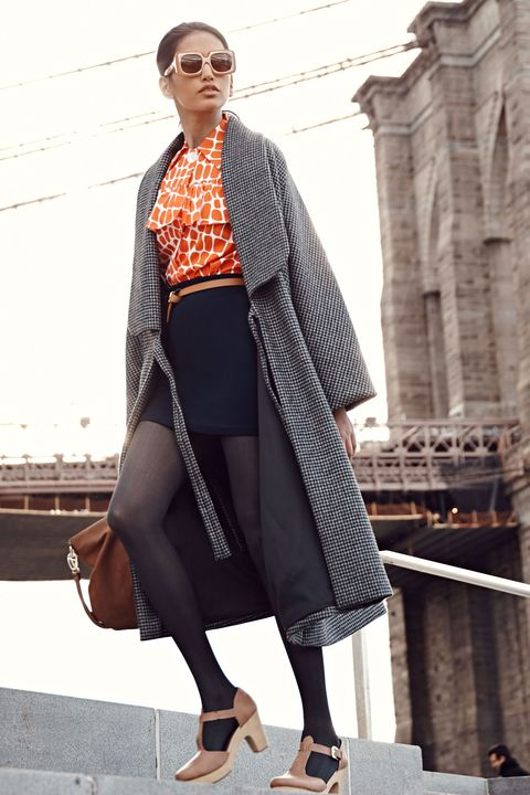 "<p>A cape-style coat instantly makes any outfit more elegant. Paired with of-the-moment accessories, like oversize sunglasses and a skinny belt, the outerwear manages to look both retro-glam and completely fresh. </p><p><em><em><em><em>Creatures of Comfort Black Loro Check Murphy Coat, $1,265, <a href=""http://shop.creaturesofcomfort.us/murphycoatwoolfeltwave.aspx"" target=""_blank"">shop.creaturesofcomfort.us</a>;</em></em></em></em><em><em><em> Miu Miu Shirt, $1,185, <a href=""http://www.miumiu.com/"" target=""_blank"">miumiu.com</a>;</em></em></em><em><em><em><em> </em></em></em>Old Navy Faux-Suede Mini Skirt, $36.94, <a href=""http://oldnavy.gap.com/browse/product.do?cid=1011458&tid=onsm004538&vid=1&pid=487227022"" target=""_blank"">oldnavy.com</a>; Old Navy Herringbone Tights, <em>$8, <a href=""http://oldnavy.gap.com/browse/product.do?cid=1032054&tid=onsm004538&vid=1&pid=601044002"" target=""_blank"">oldnavy.com</a>; </em><em>Old Navy Skinny Faux-Leather Belt, $8, <a href=""http://oldnavy.gap.com/browse/product.do?cid=45856&tid=onsm004538&vid=1&pid=123279212"" target=""_blank"">oldnavy.com</a>; Old Navy Shoes,<em> <a href=""http://oldnavy.gap.com/browse/category.do?cid=55147&tid=onsm004538"" target=""_blank"">oldnavy.com</a>; Karen Walker Hothouse Sunglasses, $349, <a href=""http://www.sunglasshut.com/au/9324976192578"" target=""_blank"">sunglasshut.com</a></em></em></em></p>"
