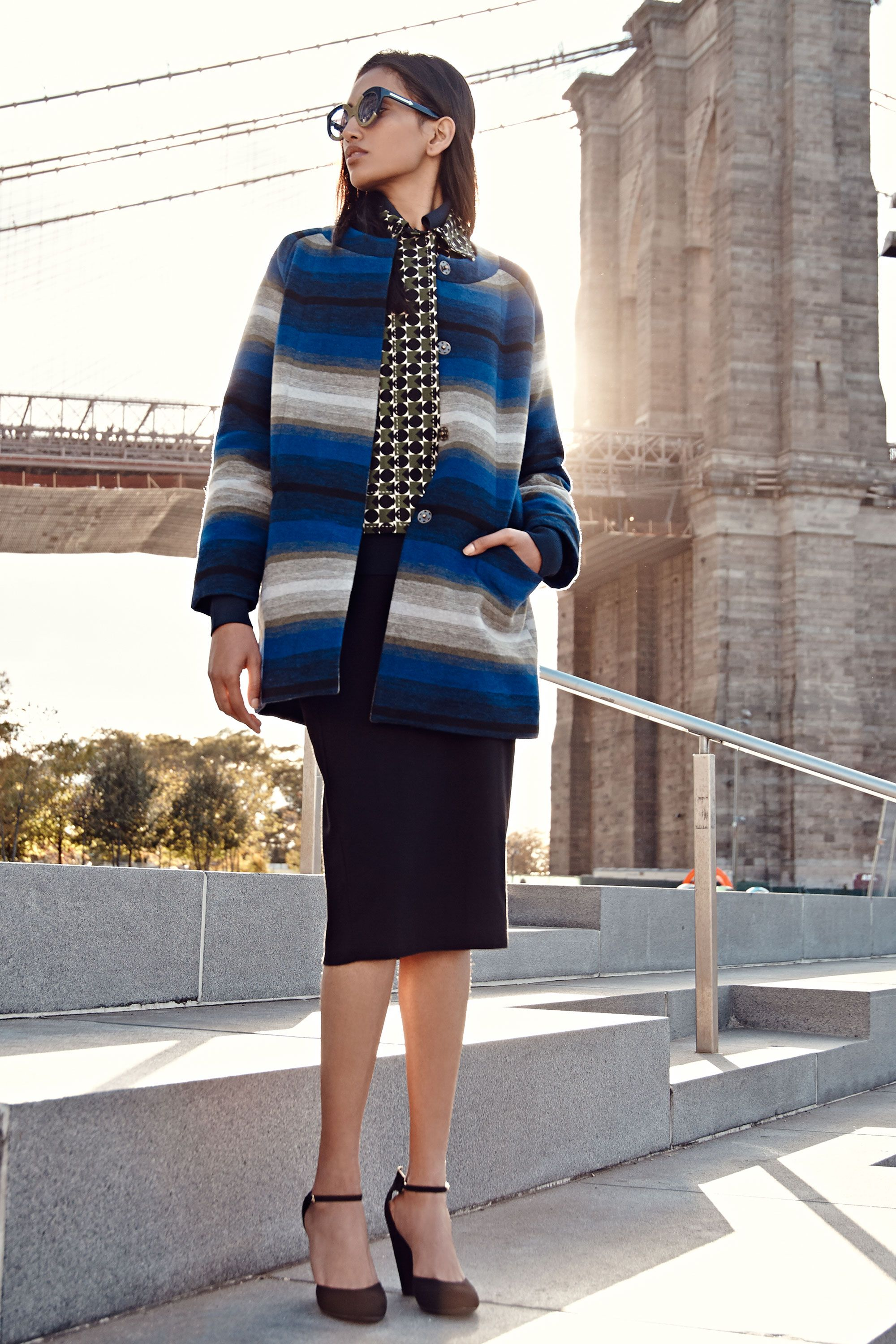"<p>Dig the spotlight? Then you'll shine in an attention-grabbing statement coat. This one's rich indigo hue and modern cut look sharp, not showy.</p><p><em><em>Old Navy Striped Collarless Jacket, $70, <a href=""http://oldnavy.gap.com/browse/product.do?cid=74688&tid=onsm004538&vid=1&pid=602590012"" target=""_blank"">oldnavy.com</a>;</em></em><em><em> Orla Kiely Jacket, <a href=""http://www.orlakiely.com/"">orlakiely.com</a>;</em></em><em><em> Old Navy Calf-Length Pencil Skirt, $17, <a href=""http://oldnavy.gap.com/browse/product.do?cid=1011461&tid=onsm004538&vid=1&pid=47774901"" target=""_blank"">oldnavy.com</a>; Old Navy Sueded D'Orsay Pumps, $34.94, <a href=""http://oldnavy.gap.com/browse/product.do?cid=55150&tid=onsm004538&vid=1&pid=780324002"" target=""_blank"">oldnavy.com</a></em></em></p>"