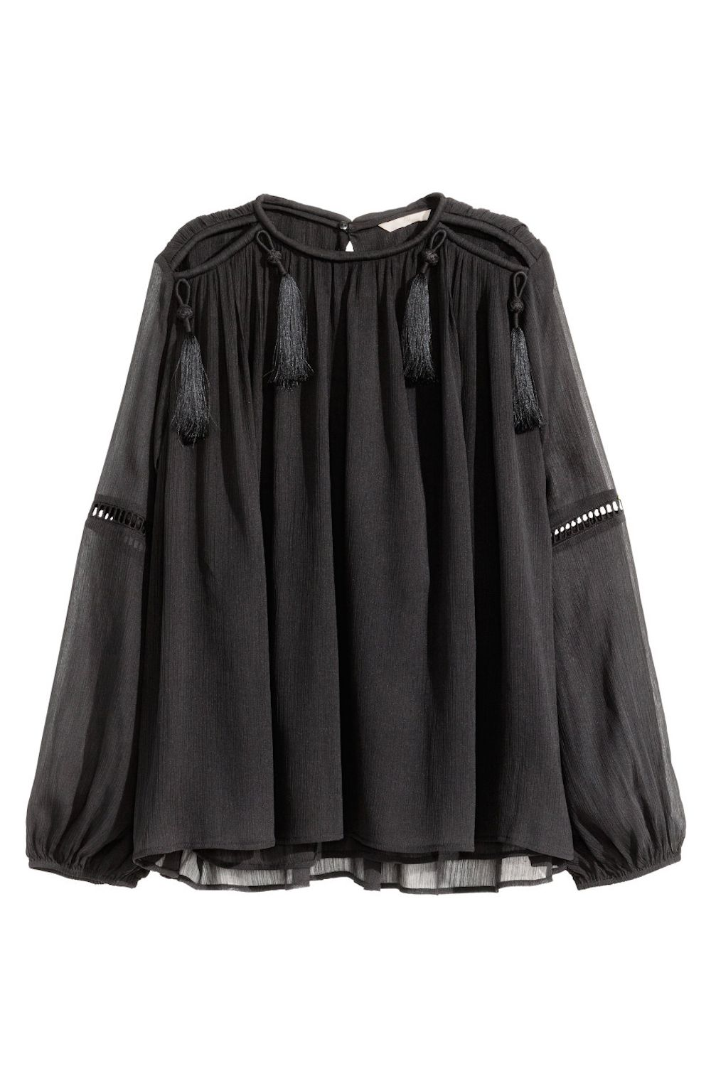 "<p>A black blouse is as versatile as it comes, but retro fringe accents make it fit for a standout lady.</p><p>H&M Chiffon Blouse, $49.99&#x3B; <a href=""http://www.hm.com/us/product/35500?article=35500-A"" target=""_blank"">hm.com</a>.</p>"