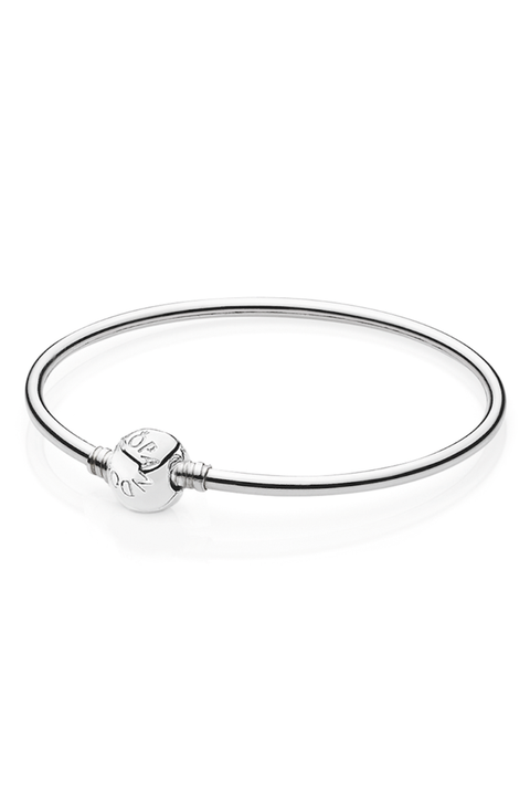 "<p>When it comes to choosing an everyday accessory for someone, you can't go wrong with a streamlined silver bangle with pendant detail.</p><p>Pandora Sterling Silver Bangle Bracelet, $65; <a href=""http://estore-us.pandora.net/en-us/sterling-silver-bangle-bracelet/590713-17.html"" target=""_blank"">pandora.net</a></p>"