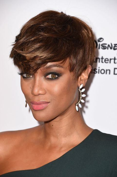 <p>The feathered 'do is definitely A+, but don't forget to smize when showing off your badass cut. </p>