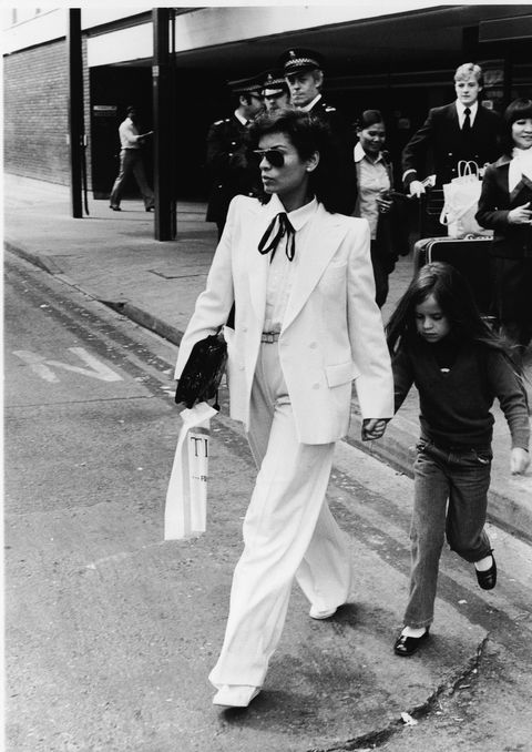 <p>Today, suits and co-ords tend to be worn closer to the body, but Bianca Jagger, as always, makes the case for a fuller cut. Wear with heels so the hem just skims the floor, shades, and swagger. </p>