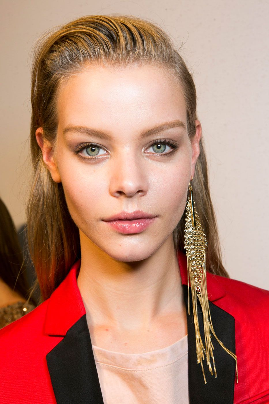 """<p>The wet look is still going strong—and we suspect it's because it's the most transformative greasy hair hack of all. Seriously, just adding sheen to the roots alone will instantly add both edge and polish to your look. At Just Cavalli, hairstylist Guido Palau blow-dried the hair  straight and created a small, '80s-inspired swoop in the front using <a href=""""http://www.ulta.com/ulta/browse/productDetail.jsp?productId=xlsImpprod12292089"""" target=""""_blank"""">Redken Stay High 18 gel-to-mousse</a>.</p>"""