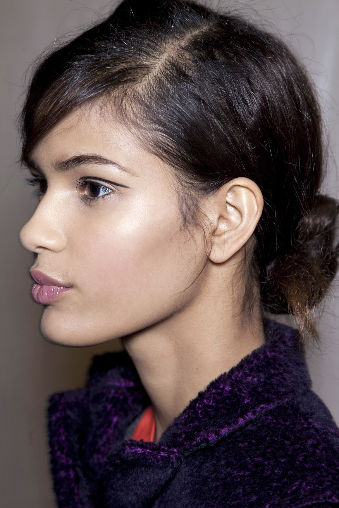 """<p>Unless its sleeked back, a bun without texture is just kind of sad. And it's that much harder to build on with just-washed hair. At Rag & Bone, Bumble and bumble stylists sought to recreate the greasy look by working <a href=""""https://www.bumbleandbumble.com/hair-styling-products/index.tmpl#1"""" target=""""_blank"""">mists and creams</a> alike into the roots. Since your hair is already dirty, all you have to do is muss things up with a teasing brush and play with the wisps around the hairline.</p>"""