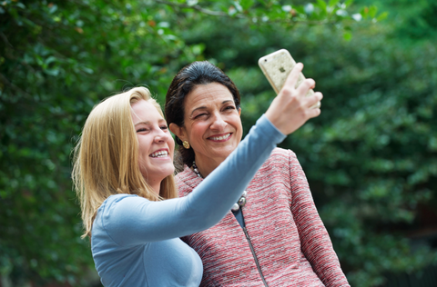 Smile, Happy, Facial expression, People in nature, Interaction, Gesture, Friendship, Love, Laugh, Sweater,