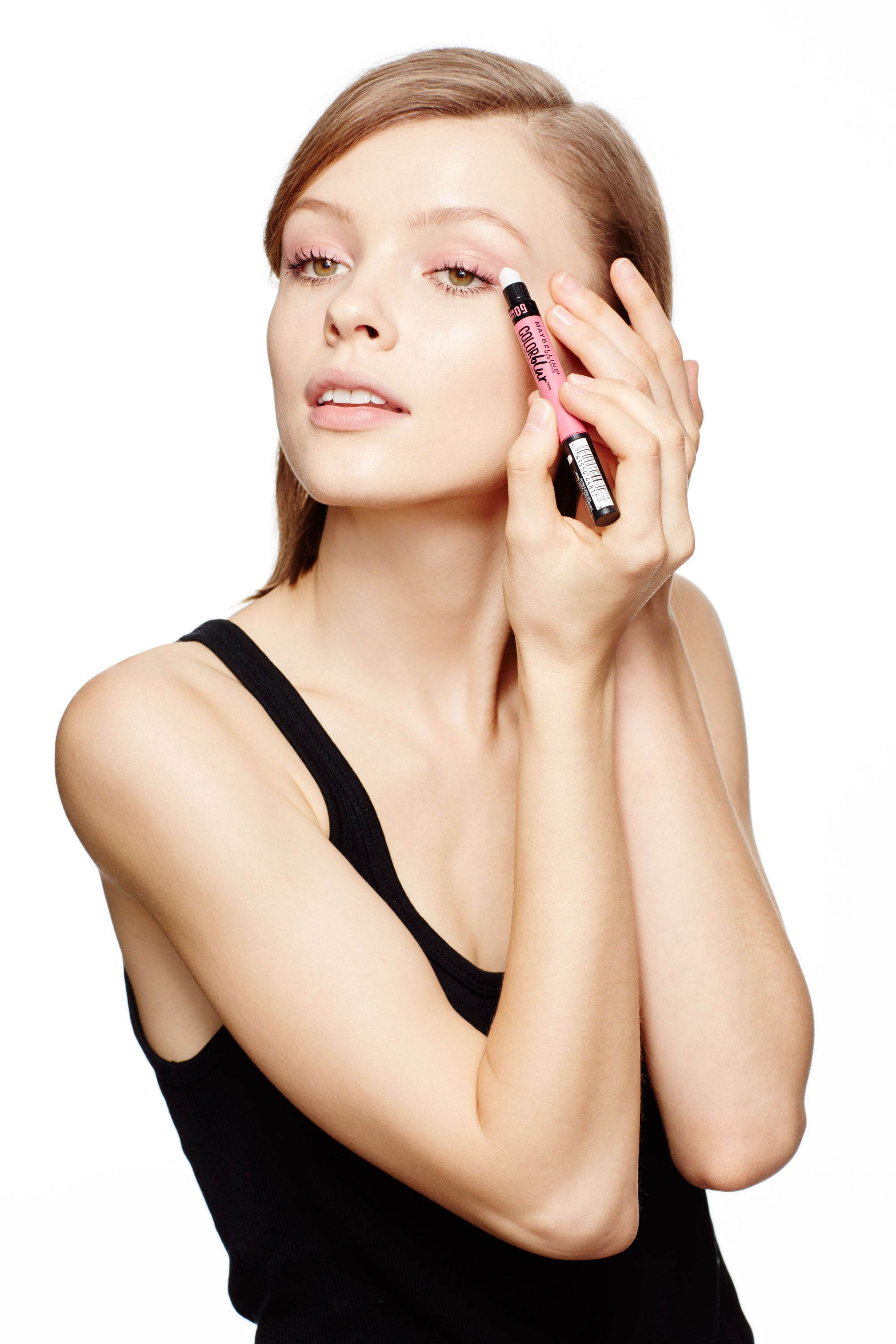 "<p>Using the precise tip of the Color Blur crayon, draw a band of pink across your upper lashes just as you would with eyeliner. Women with fairer skin tones should opt for a cool pink. (Oquendo used <a href=""http://www.amazon.com/Maybelline-New-York-Studio-Color/dp/B00YJJXC7G/ref=sr_1_1?ie=UTF8&qid=1448048306&sr=8-1&keywords=maybelline+color+blur"" target=""_blank"">I Like To Mauve It</a> here.) If you have a medium to deep complexion, reach for a warmer, orange-based hue like <a href=""http://www.amazon.com/Maybelline-New-York-Studio-Color/dp/B00YJJXC7G/ref=sr_1_1?ie=UTF8&qid=1448048306&sr=8-1&keywords=maybelline+color+blur"" target=""_blank"">I'm Blushing!</a> </p><p>Next, diffuse the pigment up towards the crease with the silicone smudger, using a gentle, windshield wiper motion. Overdosed on color? Use a tissue to blot away any excess. </p><p>""This matte lipstick goes on like a cream but dries to a powdery finish, so it sets without having to layer anything over top,"" says Oquendo. For more definition, add a coat of brown—not black—mascara to top and bottom lashes. ""I love pinks and browns together—it looks less severe,"" he says.</p>"