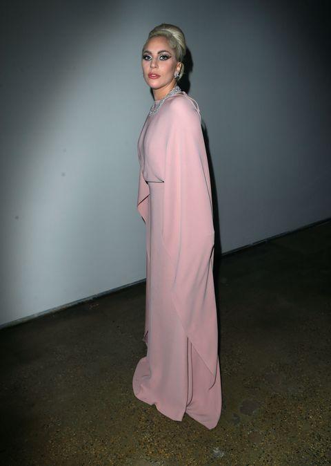 Sleeve, Shoulder, Standing, Formal wear, Fashion model, One-piece garment, Costume, Gown, Costume design, Fashion design,
