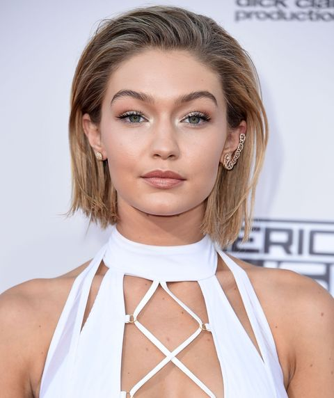 <p>Gigi takes a subtle approach to metallics with a soft smattering of iridescent peach on the lids.</p>