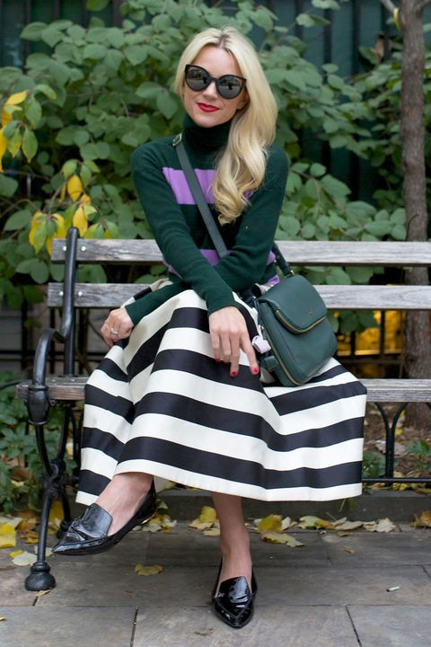 <p>Easiest pattern-mixing tip ever: Pair like with like. A bold black and white skirt plays nice with a single fat stripe on top. And see how the green handbag makes the lavender pop?  👌 </p>