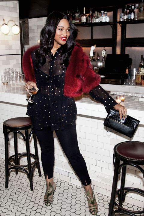 """<p>A full-on sequin/glitter/bedazzle-fest isn't for everyone. To bring on just a <em>bit</em> of the bling, consider a shimmering gold-accented blouse with glitzy sandals. Snazzy yet sophisticated.</p><p>Old Navy High-Rise Side Zip Pants in Blackjack, $32, <a href=""""http://oldnavy.gap.com/browse/product.do?cid=86370&vid=1&pid=773152002"""" target=""""_blank"""">oldnavy.com</a>; Lane Bryant Star Print Babydoll Top, $54.95, <a href=""""http://www.lanebryant.com/star-print-babydoll-top/p229329/index.pro"""" target=""""_blank"""">lanebryant.com</a>; Cheng-Huai Chuang Red Fox Fur Jacket, $2,500, <a href=""""http://www.chenghuaichuang.com/"""" target=""""_blank"""">chenghuaichuang.com</a>; Alexis Gamblin Caged Toe Bootie, $675, <a href=""""http://www.alexisgamblin.com/"""" target=""""_blank"""">alexisgamblin.com</a>; Old Navy Faux Leather Fold Over Clutch, $19.94, <a href=""""http://oldnavy.gap.com/browse/product.do?pid=596252042&vid=1&locale=en_US&kwid=1&sem=false&sdkw=faux-leather-fold-over-clutch-P596252&brandCvoSid=TDDMYCQ5M7TT&sdReferer=http%3A%2F%2Fwww.oldnavy.com%2Fproducts%2Fclutch.jsp"""" target=""""_blank"""">oldnavy.com</a>; Michelle Campbell Square Knuckle Ring, $212, <a href=""""http://www.campbellcollections.com/rings/square-knuckle-ring"""" target=""""_blank"""">campbellcollections.com</a>; Michelle Campbell Floating Stacker Ring, $240, <a href=""""http://www.campbellcollections.com/rings/floating-stacker-ring"""" target=""""_blank"""">campbellcollections.com</a><br></p>"""