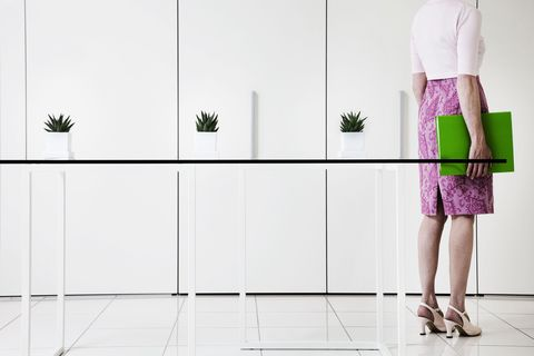 Woman in office in pink skirt and heels