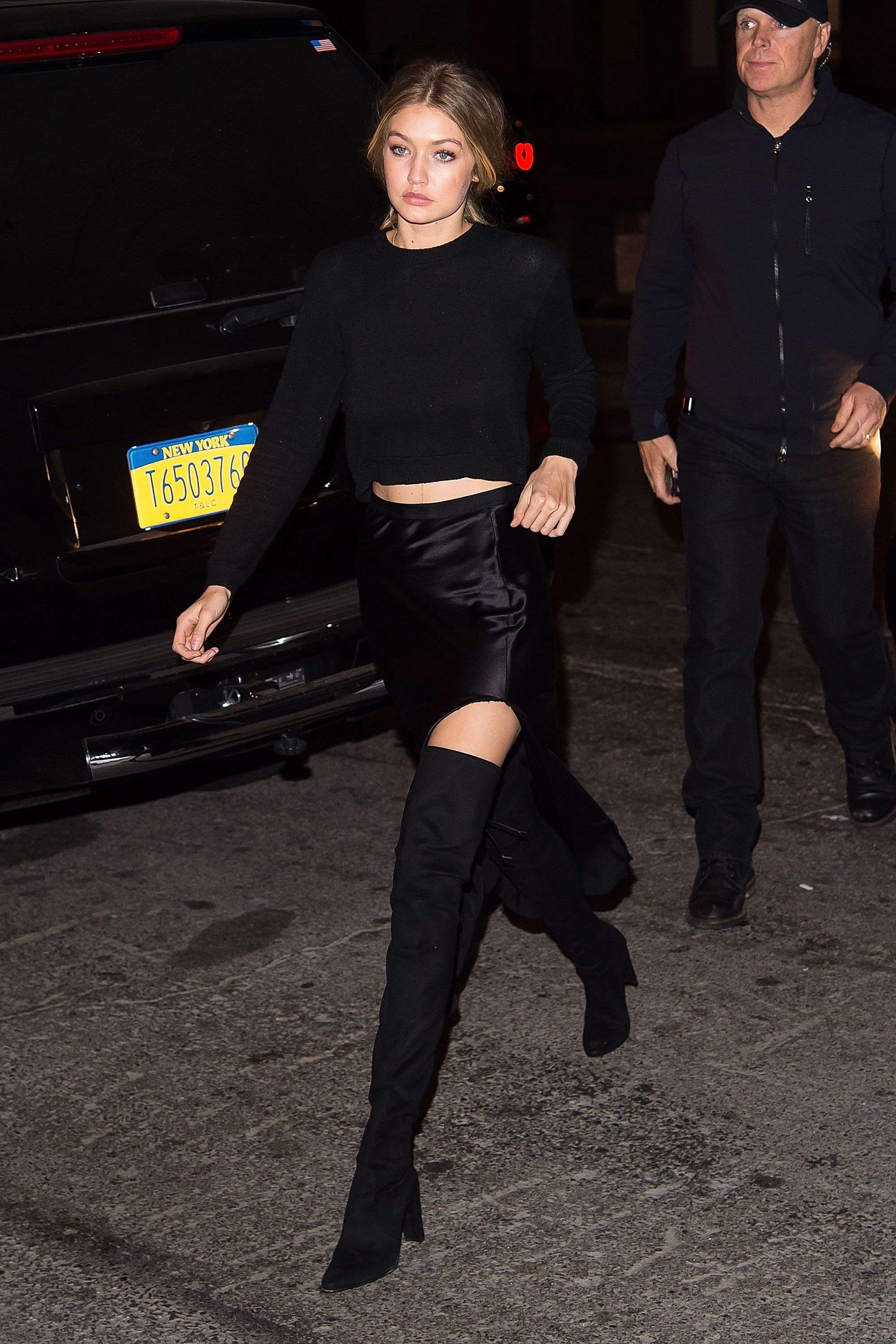 <p>It's a classic combo with endless variations (short, long, prints, etc.), but Gigi Hadid's take strikes the perfect balance between cozy and sexy, *plus* it's likely one of the warmest party outfits you could possibly wear and still look your size. </p>