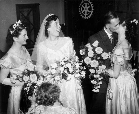 Clothing, Hair, Dress, Hairstyle, Bridal clothing, Petal, Wedding dress, Photograph, Bouquet, White,
