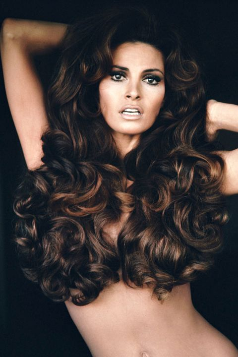 <p>The big-haired bombshell rang in a new decade with her voluminous, chest-concealing tendrils.</p>
