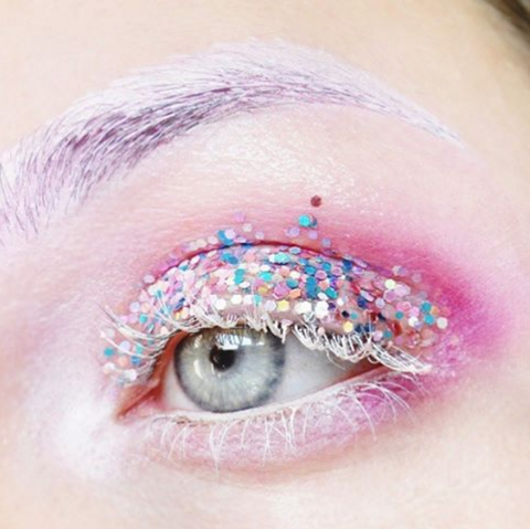 <p>Glam rock-inspired eyes aren't exactly new, but makeup artists are amping up the wattage with an even heavier dose of glitter. Whether it's the ultra-bold, color-blocked sweeps of sparkle (like on the lids on the Giambattista Valli runway) or a light dusting, it's going to make a twinkly statement. No matter how much the sparkly stuff you opt for, we suggest going for an of-the-moment glossy, wet-look finish by adding a mixing medium or vaseline to the pigment (a noted Marilyn Monroe trick, FWIW). </p>
