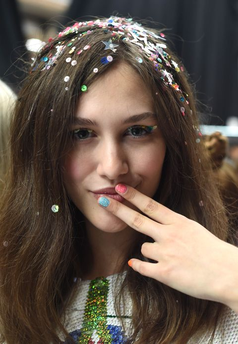 <p>As far as making it one of the biggest hair embellishment trends of 2015, all the credit goes to designer Ashish Gupta, who gave all his models confetti hair—from neon-hued to star-shaped—on his Spring 2015 runway. And it looks ravishing on brunettes...</p>
