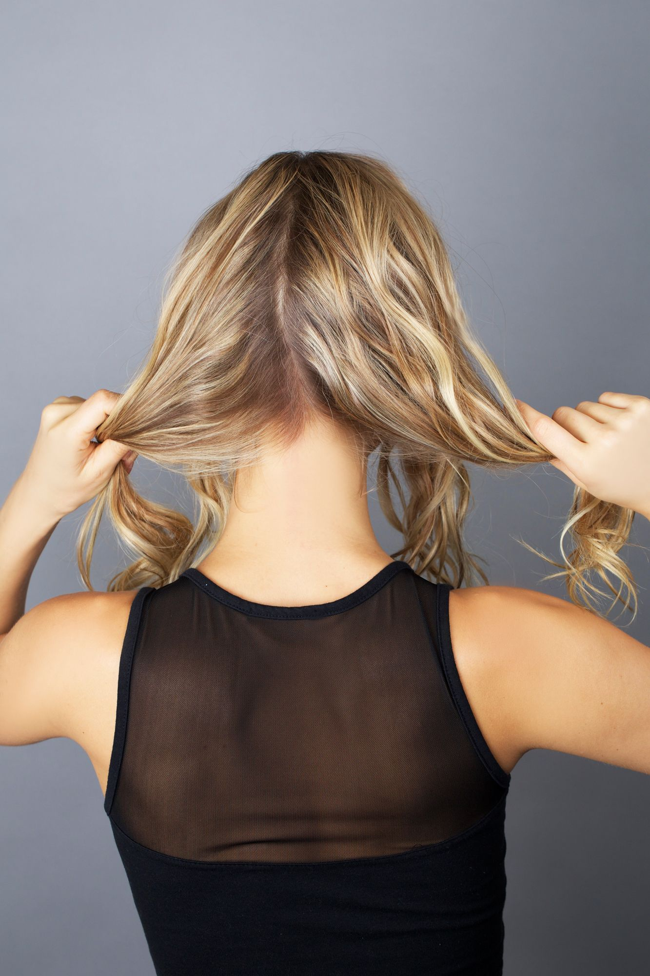<p>Separate your hair into four sections. Two on each side, one in front of your shoulders and one behind. </p>