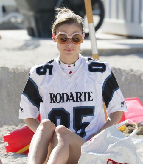 <p>Jaime King layers a jersey over her cherry-print maillot for extra sun protection *and* extra Rodarte, which every outfit needs. (That and Karen Walker 👓.) Try button-downs, light jackets—hell, even an unstructured cocktail dress will work if you're not precious about it. </p>