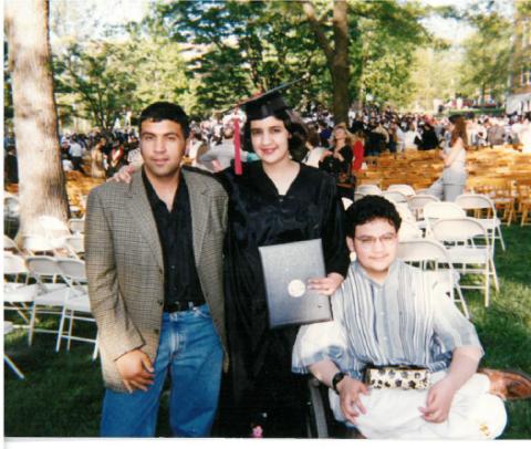Academic dress, Hat, Headgear, Scholar, Graduation, Outdoor furniture, Mortarboard, Outdoor table, Phd, Spring,