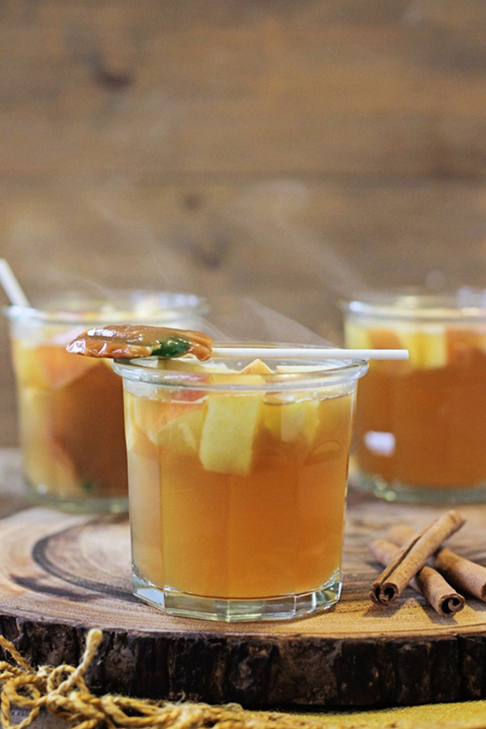 """<p><strong>Ingredients:</strong></p><p>1 quart + 1 1/2 cups apple cider</p><p>1 1/2 cups Apple liqueur</p><p>1 cup spiced rum</p><p>1/2 cup caramel-flavored syrup </p><p>3 apples, chopped</p><p>4 cinnamon sticks </p><p>Caramel apple suckers (optional)</p><p><strong>To make:</strong></p><p>1.Place everything in the slow cooker (except the suckers). Cook on the low setting for 1-2 hours. Serve warm.</p><p><em>Courtesy </em><a href=""""http://busy-mommy.com/2014/10/hot-caramel-apple-cocktail.html """" target=""""_blank""""><em>busy-mommy.com</em></a></p>"""