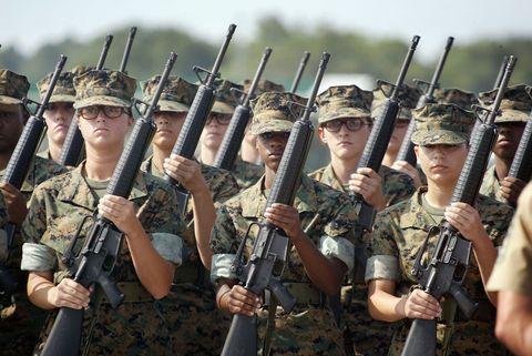 Soldier, Social group, Gun, Military uniform, Uniform, Headgear, Team, Military organization, Military, Troop,