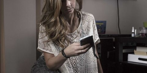 Woman on her smartphone, cropped