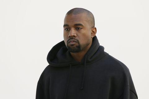 Sleeve, Outerwear, Standing, Facial hair, Collar, Jacket, Sweatshirt, Neck, Hood, Buzz cut,