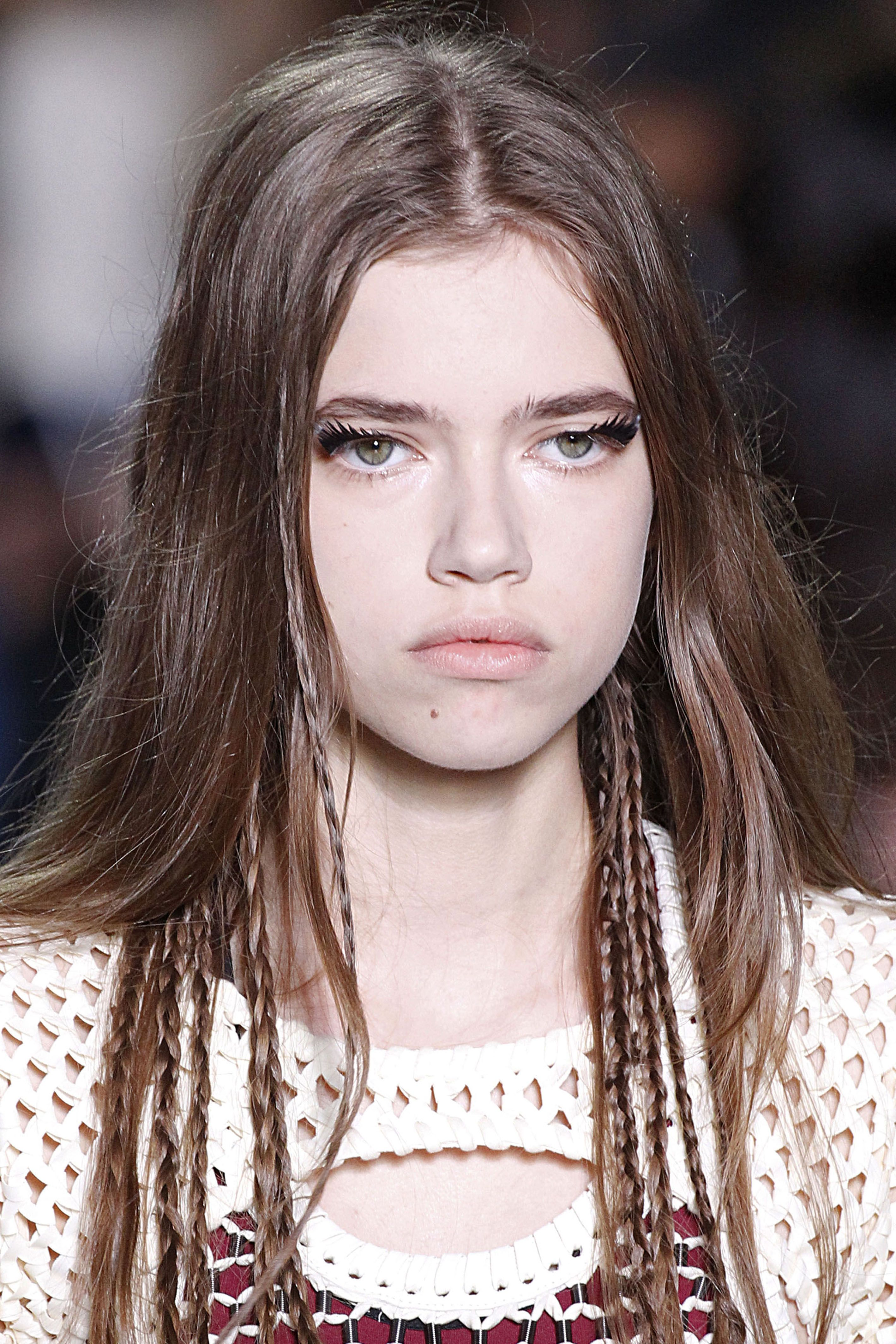 <p>Embrace your natural texture, but change things up with a few tiny braids that frame the face or stick out from the nape as seen at the Louis Vuitton Spring 2016 show. If you want to go sans elastic, spray your strands with dry shampoo and they'll stay put on their own.</p>