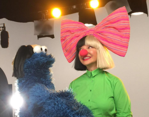 Sia Makes An Appearance On Sesame Street And Brings Wigs For Everyone