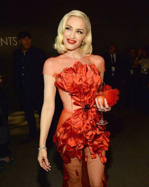 Red, Lipstick, Fashion accessory, Fashion, Thigh, Fashion model, Waist, Costume, Model, Makeover,