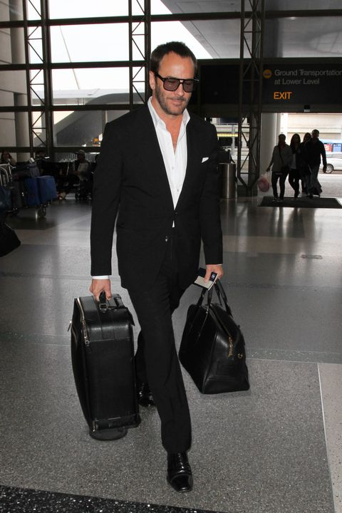 <p><strong>The look:</strong> A trim suit, white shirt, and not a laser-precision-trimmed hair out of place. Not even at the airport. </p>