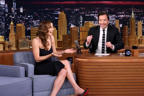 Coat, Tie, Suit, Dress shirt, Dress, Thigh, Foot, Conversation, Television program, Television presenter,