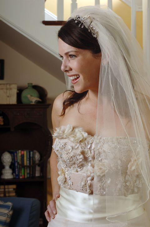 Clothing, Bridal veil, Bridal clothing, Veil, Sleeve, Shoulder, Bridal accessory, Textile, Photograph, Dress,