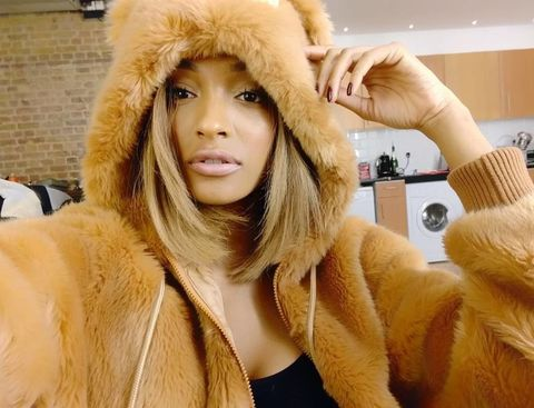 Fur clothing, Textile, Natural material, Animal product, Winter, Headgear, Fashion, Fur, Beige, Costume accessory,