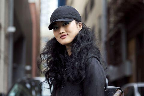 Lip, Cap, Jacket, Black hair, Street fashion, Headgear, Beauty, Long hair, Fur, Model,