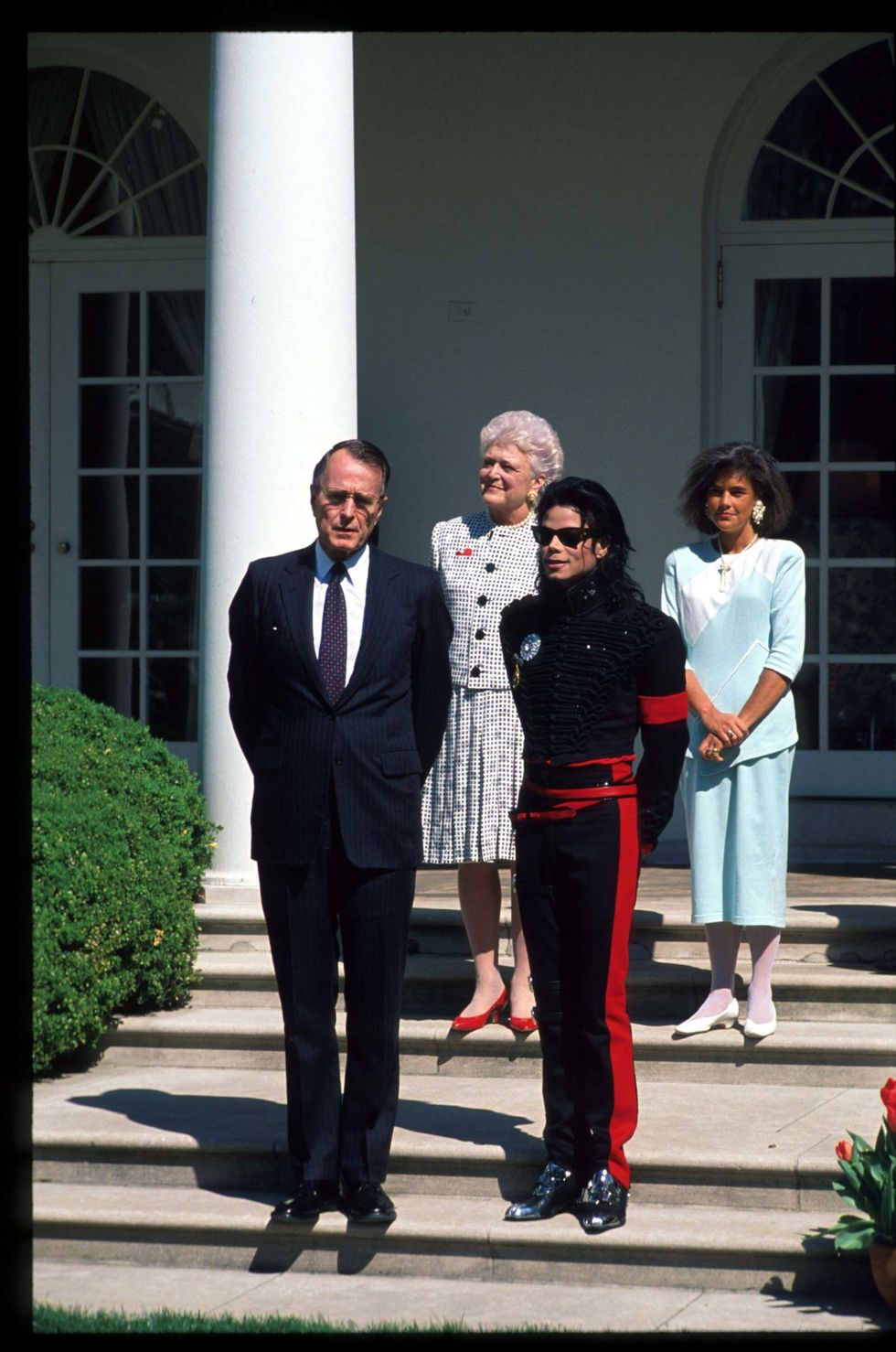 "Michael Jackson With George H.W. Bush Michael Jackson visited the White House in this snazzy black and red military-inspired ensemble in 1990 when he received the ""Artist of the Decade"" award from the first President Bush. The megastar received this honor more than one time throughout his life."