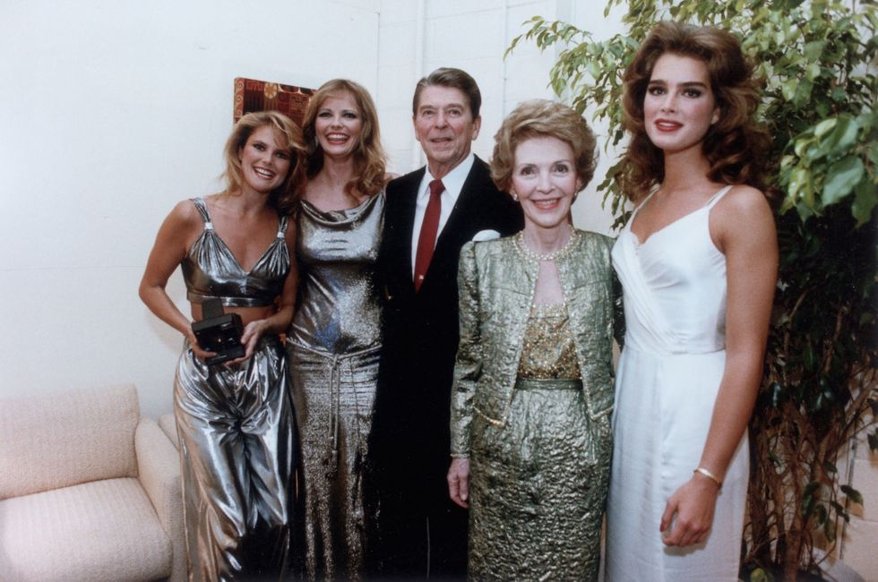 Christie Brinkley, Cheryl Tiegs, and Brooke Shields With Ronald Reagan President Reagan and his wife Nancy snapped a quick photo with the famous supermodels at a Tribute to Bob Hope's 80th birthday at the Kennedy Center in 1983. All the women were in gowns—Brinkley in a two-piece number (a look that's recently back in style )!