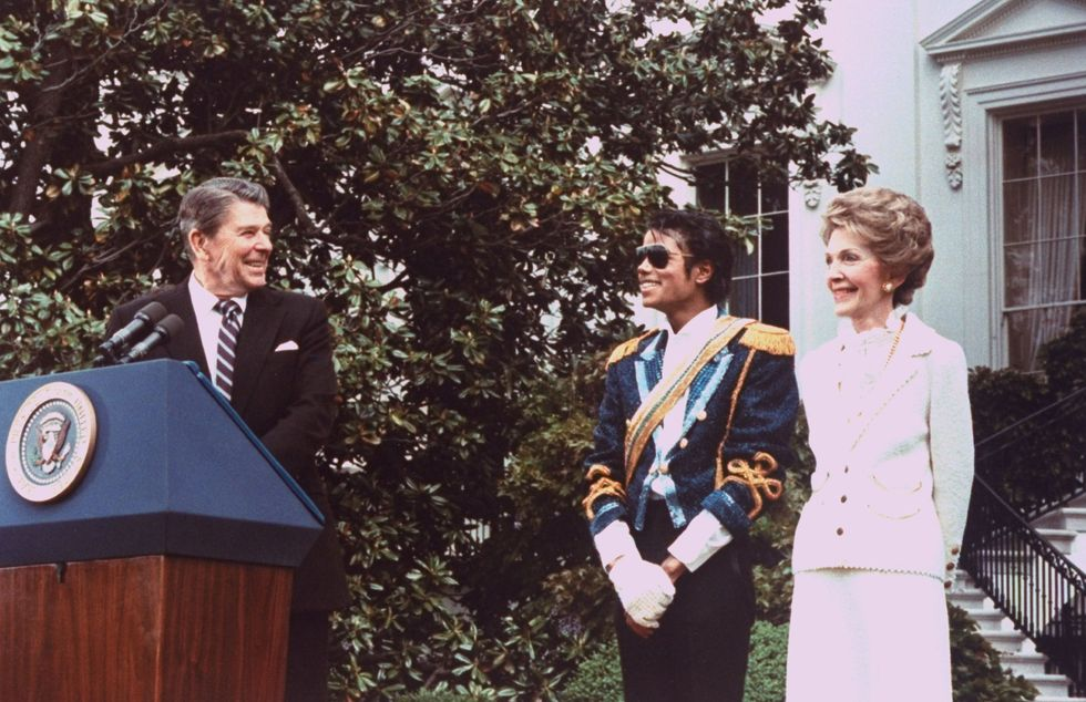"Michael Jackson With Ronald Reagan President Ronald Reagan awarded Michael Jackson with the Presidential Public Safety Communication Award; the award was the result of MJ's classic song ""Beat It"" being used as the anthem of Reagan's public service campaign against teen drinking and driving. The King of Pop donned a single glove, naturally."