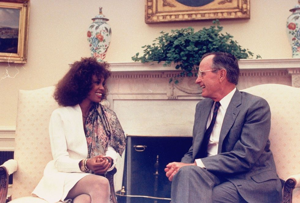 "Whitney Houston With George H.W. Bush Music legend Whitney Houston got a private tour of the White House from the president himself 1990. During that visit, President Bush named the icon a ""Point of Light Contributing Leader."""